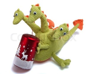 http://www.colourbox.com/image/toy-as-knitted-dragon-with-christmas-candle-image-3066273?utm_expid=22365066-19.-Pt57g7ESZWN_tKflGYEWg.0&utm_referrer=https%3A%2F%2Fwww.google.co.uk%2F