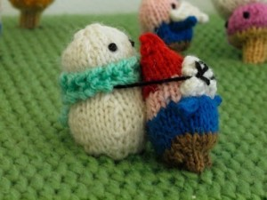 Ah the season of goodwill,and the age old conflict of snowmen v elves. Here's a rare picture of an elf getting beasted by a snowman. As you're probably aware, it's usually the other way around. Those elves, very underhand.  Source: http://www.neatorama.com/2011/11/14/snowmen-vs-gnomes-knitted-battlescape/#!oPEyA