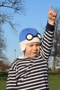 Look at that crazy social juxtaposition - boy dressed as Biggles doing an almost-Nazi salute.